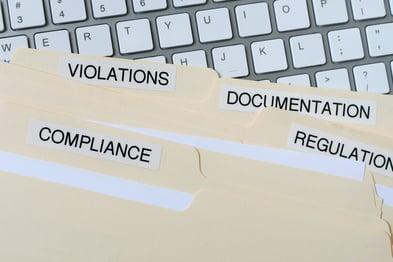 file-folders-with-words-compliance-violations-docu-75U52GH